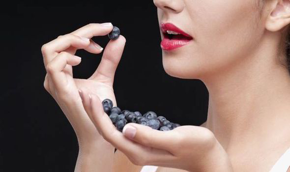 Woman-eating-blueberries-551212